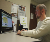 Jason Goss gets familiar with NCWorks Online at Charlotte Works's newest SNAP site at Charlotte Bridge Home. The 10-year Air Force veteran and current National Guard member is searching for a position as a data or criminal analyst.