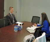 Alexander Aycock interviews with Coca-Cola Bottling Company Consolidated Sales and Distribution Manager Tammy Caplan at a recruiting event at Charlotte Works' Employer Engagement Center on Dec. 17.