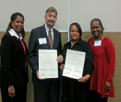 From left, Wendy Lyons, talent engagement manager (WMS); Randall Darnell, manager (ECD); Stephanie Lattimore, manager (FPB); and Jaslyn Roberts, talent engagement director (WMS) celebrate in Raleigh after the other two NCWorks Career Centers in Mecklenburg County were certified.