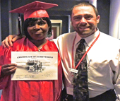 Elizabeth Johnson celebrates graduating from truck driving school with Charlotte Works Career Coach Jeff Adams.