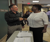U.S. Navy veteran Melody Mganga (R) thanks Scott Killoran, disabled veteran employment consultant (ECD), for providing helpful resources at the June 22 NCWorks Career Center hiring event June 22.