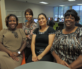 "Margarita Gonzalez Rocha (second from right) is surrounded by her training team at the NCWorks Career Center – Executive Center Drive. From left is Career Coach Anastasia Knight; Claritza Abreu, intake specialist; and Pamela Jackson-Huffin, training coordinator. ""I'm so appreciative of all the support from everyone at NCWorks!"" says Gonzalez Rocha. ""They stay with people till the end – they don't just pay for training and leave us alone!"""