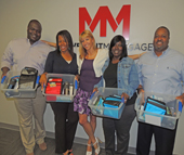 Charlotte Works' partner agency, Charlotte Bridge Home (CBH) surprised four clients with boxes of work goodies. Pictured left to right are James Murdough, veteran; Valaria Weaver, military spouse; Tiann Shade, veteran employment and education specialist (CBH); Kim Bryant, veteran; and Leon Tyner, veteran.