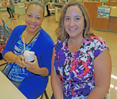 NCWorks Career Center volunteers Adrian Cross (l) and Andrea Campbell (r) enjoyed a cool treat and camaraderie at the ice cream social hosted by NCWorks Career Center and Publix.