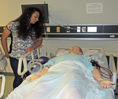 Youth Works participant Wendy De Leon Hernandez learns about the respiratory therapy program at Central Piedmont Community College (CPCC) as part of the Healthcare Career Exploration Day. Students visited the lab area designed to represent a hospital ward, complete with computerized patients, to demonstrate real-life situations.
