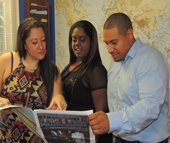 "(From left), Publisher Kim Weatherell, Foundation General Manager Andra Summey and Distribution and Creatives Coordinator Peter Bush check out the latest issue of ""Metro Proponent,"" a monthly publication aimed at young professionals, entrepreneurs and creative types. Weatherell used On-The-Job Training Grants from Charlotte Works to hire both Summey and Bush."