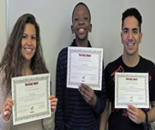 (From left) Ci'erra Larsen, Simeon Holmes and John Helny became the first youth graduates of the Working Smart: Soft Skills for Workplace Success program. Charlotte-Mecklenburg Schools are making the program a requirement before students can be placed for internships.