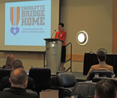 Cindi Basenspiler, executive director of Charlotte Bridge Home, addresses attendees at the 2nd Annual Charlotte Alliance for Veteran Employment (CAVE) Summit on Oct. 26.
