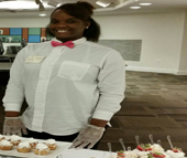 """Chandler Bowden discovered her passion for baking as a survivor of domestic minor sex trafficking when she was referred to Market Your Mind. Two years later, she is the head baker at Neet's Sweets, the bakery started by Market Your Mind Founder and Executive Director Antonia """"Neet"""" Childs. Bowden was the lead caterer for Neet's Sweets at the Levine Museum of the New South's """"Cuisine with a Conscience"""" event on Dec. 1."""
