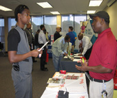 Bojangles Unite Director Albert Horne (R) discusses leadership opportunities with Army veteran Terrell Lewis (L) at the NCWorks veteran job fair on Nov. 12.