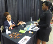 Erika Shorty, business services representative – youth, speaks with a student about Charlotte Works' work-based learning opportunities at the third annual Charlotte Career Discovery Day on April 13.